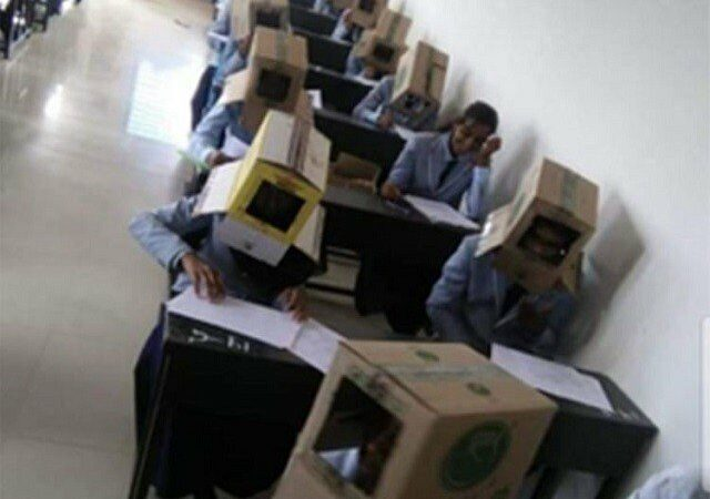 Indian students forced to wear cartons on their heads
