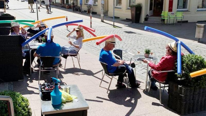 German cafe using pool noodles to ensure social distancing