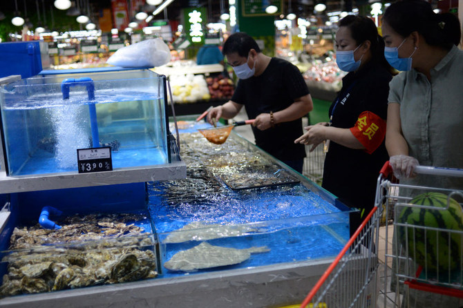 Officials in Beijing highlight risk of virus contamination through food packaging