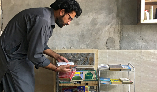 Secondary school student in KP promotes reading by donating books to barbers
