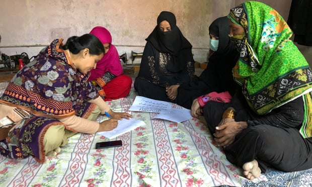 Home-based 'invisible' workers, mostly women, officially register as workers in Sindh