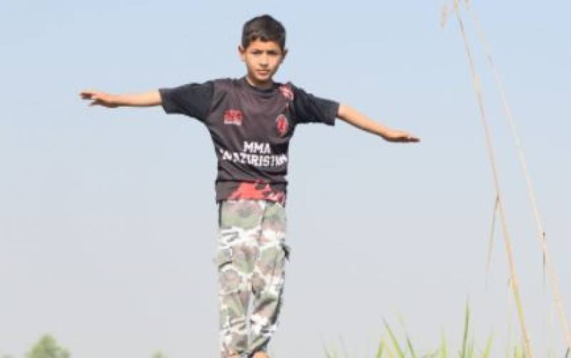 Eight-year-old Pakistani gymnast breaks Guinness world record for most Kip-ups in 30 seconds