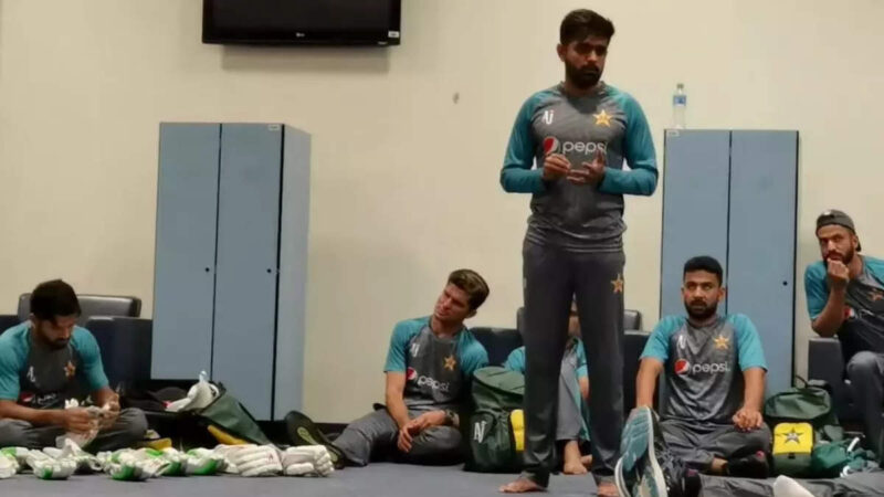 Babar Azam talks to the players
